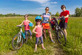Happy family on bikes, cycling outdoors Stock Image