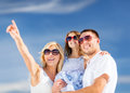 Happy family with blue sky Stock Images
