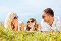 Happy family with blue sky and green grass summer holidays children people concept Royalty Free Stock Images