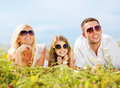 Happy family with blue sky and green grass summer holidays children people concept Stock Images