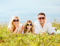 Happy family with blue sky and green grass summer holidays children people concept Stock Photography