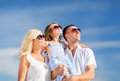 Happy family with blue sky summer holidays children and people concept Stock Photos