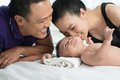 Happy family bonding newborn son Stock Photo