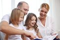 Happy family with book at home Royalty Free Stock Photo