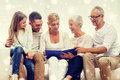 Happy family with book or photo album at home Royalty Free Stock Photo