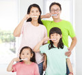 Happy family brushing their teeth her Stock Images