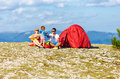 Happy family camping in mountains high Stock Photography
