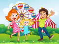 A happy family at the carnival in the hilltop illustration of Royalty Free Stock Images