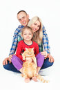 Happy family and a cat sitting in the studio. Royalty Free Stock Photo
