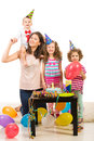 Happy family celebrate birthday of mother with three kids first of boy Royalty Free Stock Image