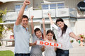 Happy family celebrating buying their new house Royalty Free Stock Photo