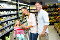 Happy family checking grocery list Royalty Free Stock Photo