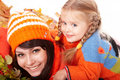Happy family with child on autumn orange leaf. Royalty Free Stock Image