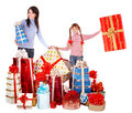Happy family with child and group gift box. Royalty Free Stock Photo