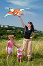Happy family and children  fly  kite. Royalty Free Stock Photos