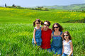 Happy family with children having fun outdoors on green field spring vacation kids in tuscany italy Royalty Free Stock Image