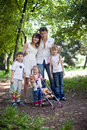 Happy family and  children in park. Royalty Free Stock Photo