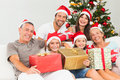 Happy family at christmas holding gifts Royalty Free Stock Photo