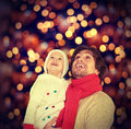 Happy family and a christmas miracle father child baby daughter Royalty Free Stock Image