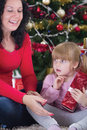 Happy family at christmas night mother and daughter Royalty Free Stock Photos