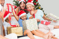 Happy family at christmas opening gifts together Royalty Free Stock Photo