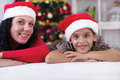 Happy family at christmas woman and little boy in front of tree Royalty Free Stock Photography