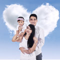 Happy family with cloud of love portrait asian shaped heart Stock Photography
