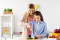Happy family cooking dinner at home kitchen Royalty Free Stock Photo