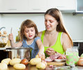 Happy family cooking soup at kitchen Stock Image