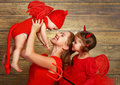 Happy family with costumes devil prepares for Halloween Royalty Free Stock Photo