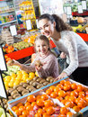 Happy family customers buying ripe fruits Royalty Free Stock Photo