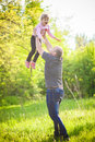 Happy family Dad throws daughter Royalty Free Stock Photo