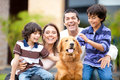 Happy family with a dog Royalty Free Stock Photos