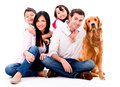 Happy family with a dog isolated over white background Stock Image