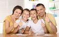 Happy family drawing at the table together Royalty Free Stock Photo
