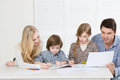 Happy family drawing together Royalty Free Stock Photo