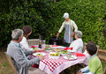 Happy family eating in the garden Royalty Free Stock Photo