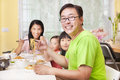 Happy family eating noodles at home asian Stock Photo