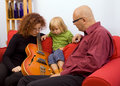 Happy family with electric guitar Royalty Free Stock Photo