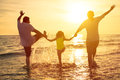 Happy family enjoy summer vacation on the beach Royalty Free Stock Photos