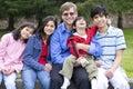 Happy family enjoying day at park Royalty Free Stock Photo