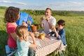 Happy family enjoying lunch outdoors Royalty Free Stock Photo