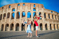 Happy family in Europe. Parents and kids in Rome over Coliseum background. Royalty Free Stock Photo
