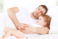 Happy family father and child baby daughter sleeping in bed Royalty Free Stock Photo
