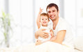 Happy family father and child  daughter playing in bed Royalty Free Stock Photo