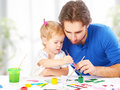 Happy family father and child daughter together draw paints Royalty Free Stock Photo