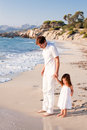 Happy family father and daughter on beach having fun Royalty Free Stock Photo