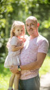 Happy family - father with daughter in summer park - vertical Royalty Free Stock Photo
