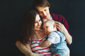 Happy family father mother and baby son on  black background Royalty Free Stock Photo