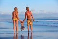 Happy family - father, mother, baby son on sea beach holiday Royalty Free Stock Photo
